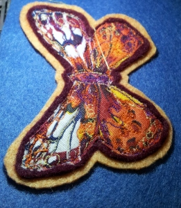 Butterfly brooch attachingh first felt layer