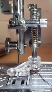 Darning Foot attached to machine front view