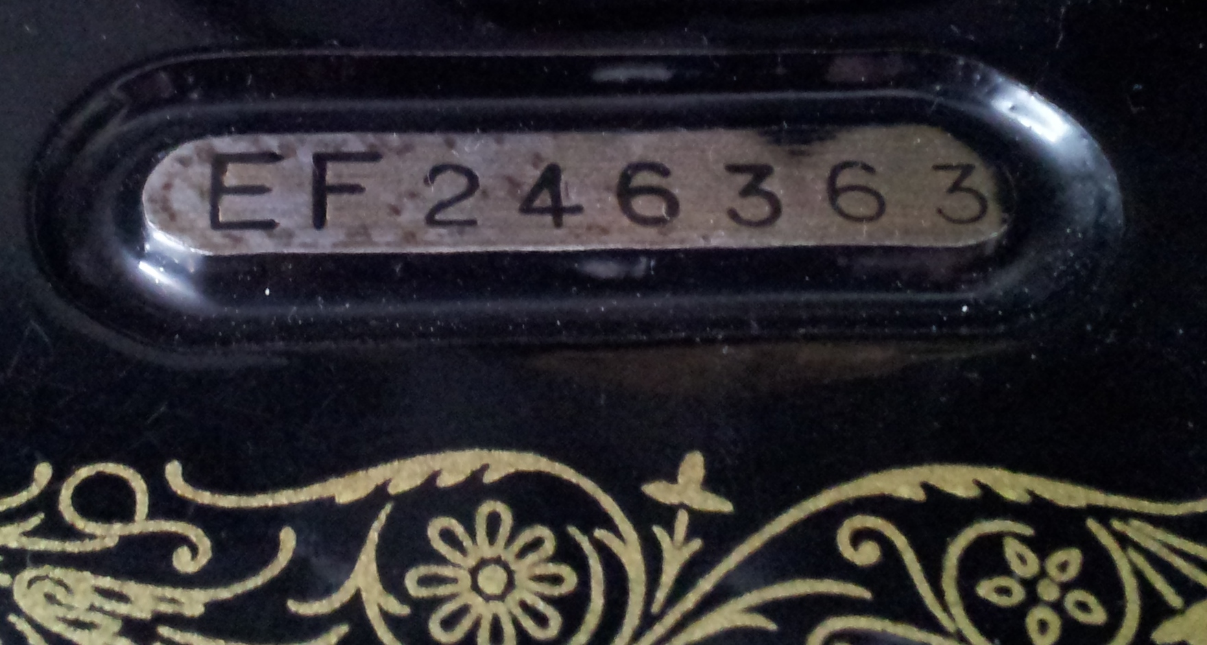 singer sewing machine serial number location