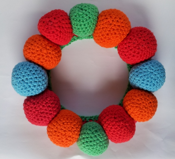 Crochet Balls sewn in place on christmas wreath