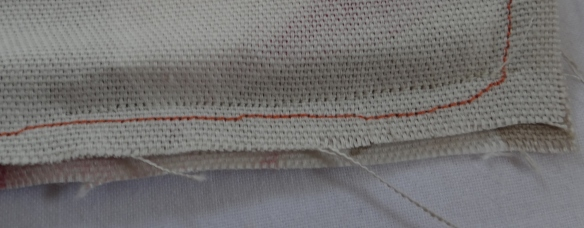 Pin and sew bottom edge of cushion