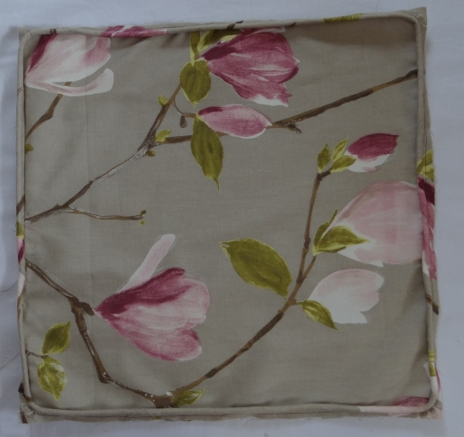 Piping sewn around cushion panel