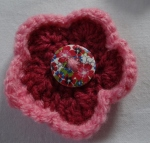 pink flower with button