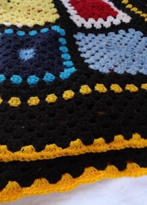 Adding yellow crochet edge to picnic blanket