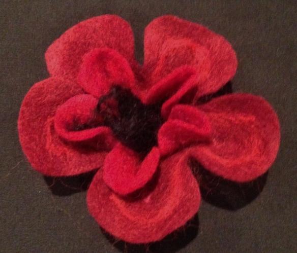 finished flat needle felted flower