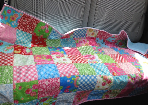 blanket on back seat of Fiat 500