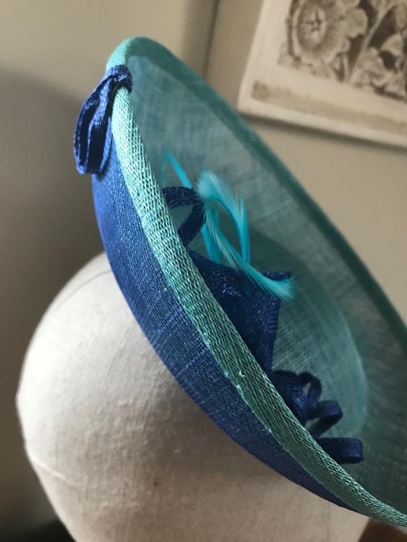 aqua and royal sinamay saucer perching hat. Isabella Josie