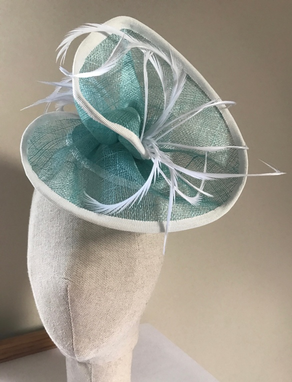 aqua free form sinamay swirl with feather trim. Isabella Josie